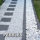 Mix different types of pebbles and pavers for dramatic effect